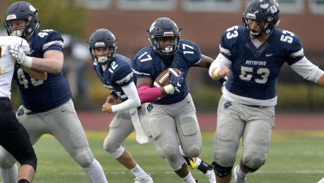 Pittsford's Chris Cox looks for a running lane at the line of scrimmage during a Section V Class AA semifinal against McQuaid played at SUNY Brockport, Saturday, Oct. 28, 2017. No. 1 seed Pittsford advanced to the Class AA final with 35-27 win over No. 5 seed McQuaid.