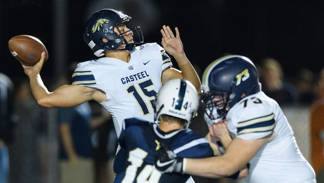 Casteel's Gunner Cruz (#15) passes in the third quarter of their AIA Div 3A championship high school football game on Saturday, Nov. 25, 2017, at Campo Verde High School in Gilbert, Ariz.