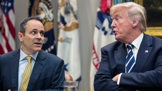 President Donald Trump, right, and Kentucky Gov. Matt Bevin, left, talk Jan. 11, 2018, during a roundtable in the Roosevelt Room of the White House in Washington. The next day, the state announced that it received a waiver from the Trump administration that will allow it to require many of its Medcaid recipients to work.
