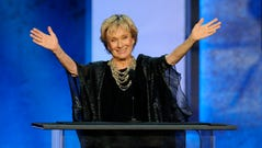 Actress Cloris Leachman gestures to honoree Mel Brooks in the audience during the American Film Institute's 41st Lifetime Achievement Award Gala in June 2013 in Los Angeles.