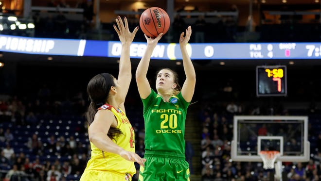 Mar 25, 2017; Bridgeport, CT, USA; Oregon Ducks guard Sabrina Ionescu (20) shoots against Maryland Terrapins center Brionna Jones (42) during the first half in the semifinals of the Bridgeport Regional of the women's 2017 NCAA Tournament at Webster Bank Arena. Mandatory Credit: David Butler II-USA TODAY Sports