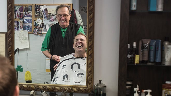 Hank Malone, owner of Gentleman's Styling Salon for over 40 years, jokes with Mayor Luke Feeney about retiring at 71 and how Feeney, who has been coming to Malone to get his hair cut every three weeks for the past five years, along with several others will have to look for another barber.