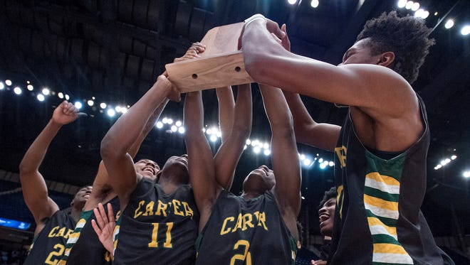 Carver players hoist their AHSAA 6A State Championship trophy after defeating Paul Bryant at Legacy Arena in Birmingham, Ala. on Saturday March 3, 2018.