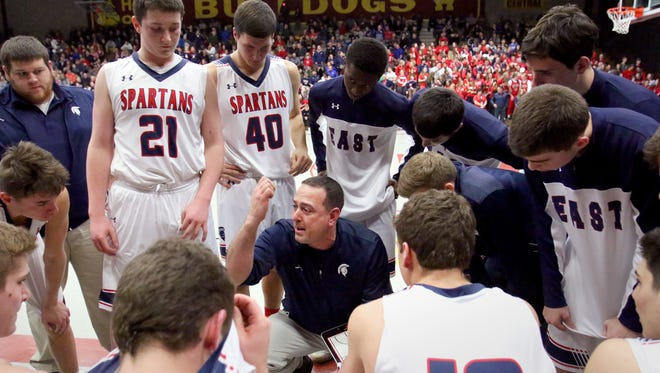 Brookfield East's Coach Joe Rux calls a timeout to talk with the team while enroute to its WIAA Division 1 81-63  win over Racine Park at West Allis Central High School on March 10.