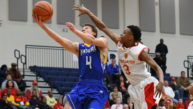 Adam Wieczorek (4) lays the ball up against DeAirius Barker (3) of NCH in the OHSAA Regional, Trent Arena, Kettering, OH, Wed. March 14, 2018