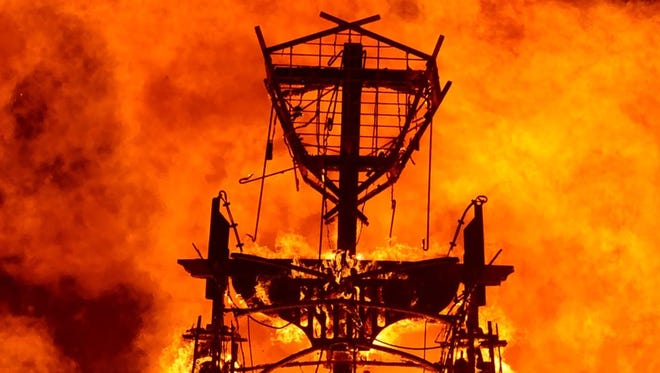 """The """"man"""" burns in Aug. 31, 2013, during Burning Man 2013 in the Black Rock Desert in Northern Nevada."""