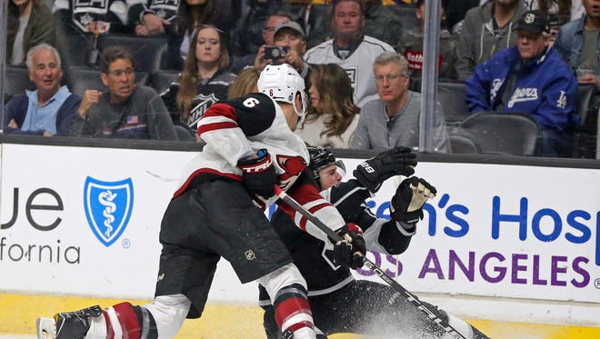 Arizona Coyotes defenseman Jakob Chychrun (6) collides with Los Angeles Kings left winger Tanner Pearson (70) during the second period of an NHL hockey game in Los Angeles Thursday, March 29, 2018. Chychrun was penalized for high-sticking. (AP Photo/Reed Saxon)