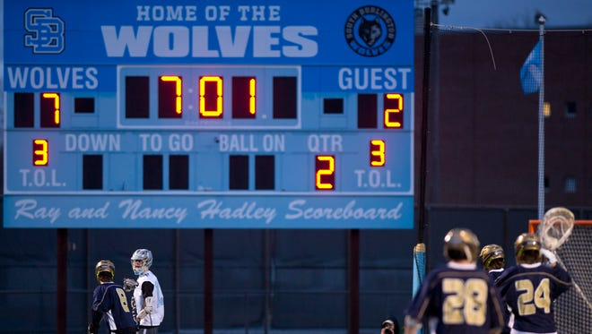 South Burlington controls the possession against Essex during a boys lacrosse game at South Burlington on Wednesday, April 18, 2017.