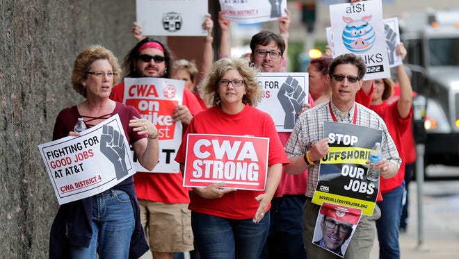 Members of of CWA Local 4621 picket outside of AT&T on Thursday in downtown Appleton.