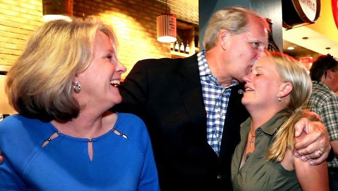 Theresa Ketron, left smiles as her husband Bill Ketron, center, who won the Rutherford County Mayor's race hugs her and hugs and kisses their daughter Kelsey Ketron, right, on the head, who won the State Executive Committeewoman Dist. 13 race, during a victory party at Puckett's Grocery & Restaurant in Downtown Murfreesboro, on election night, Thursday, Aug. 2, 2018.