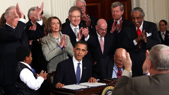 President Obama signs the health care law in March 2010.