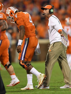 Clemson quarterback Deshaun Watson (4) walks off the field with head coach Dabo Swinney after throwing an interception to Pitt during the 4th quarter on Saturday, November 12, 2016 at Clemson's Memorial Stadium.