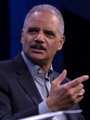 Former U.S. attorney general Eric Holder speaks during