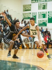 Parkside's Colen Gaynor (12) works to the basket while guarded by Washington's Shakur Cottman (13) in Salisbury on Thursday night.