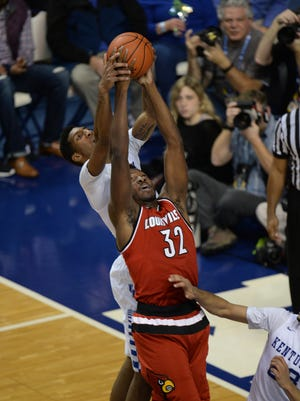 UofL's Chinanu Onuaku grabs a rebound during the University of Kentucky mens basketball game against University of Louisville at Rupp Arena in Lexington, Ky., on Saturday, December 26, 2015. Photo by Mike Weaver