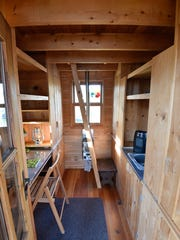 View of the desk and kitchen areas in the tiny home that Dragonfly Leathrum of Newark recently purchased.