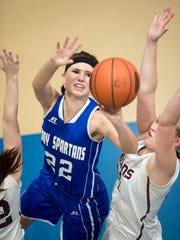 Spartan's Bronwyne Mellott takes a shot at the basket as Southern Fulton's girl try to block her during a the District 5 girls basketball championship in Johnstown, Pa. on Saturday, Feb. 27, 2016. Southern Fulton defeated McConnellsburg 50-41.