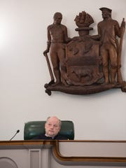 Chief Justice Leo E. Strine, Jr. listens to oral arguments before the Delaware Supreme Court. The court found that a lower court judge abused its discretion by releasing Catherine Culp, an inmate convicted of murdering her boyfriend, before the completion of her 25-year sentence.