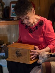 Ellen Stubbs of Frederica holds the urn of ashes of her late son, Ralph A. Kline.  They were returned from a man southern Louisiana who found them while digging through some garbage.