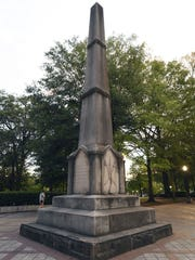 A man walks past the Confederate Monument in Birmingham,