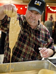 The Fish Fry at the Christian Moerlein Taproom on Friday, February 16, 2018 was for the benefit of St. Francis Seraph Parish and School. Volunteer Rick Wehrle of Colerain batter dips a piece of fresh Altantic cod before frying.