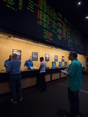 Single-game sports betting has begun at Dover Downs Hotel & Casino in Dover. Cash flowing through the state's new-look sports betting business is dwarfing the amount wagered last year.