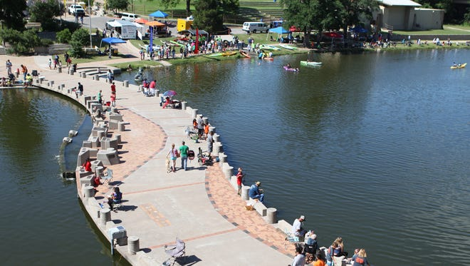 Families gather at the Concho River for fishing and kayaking in 2015.