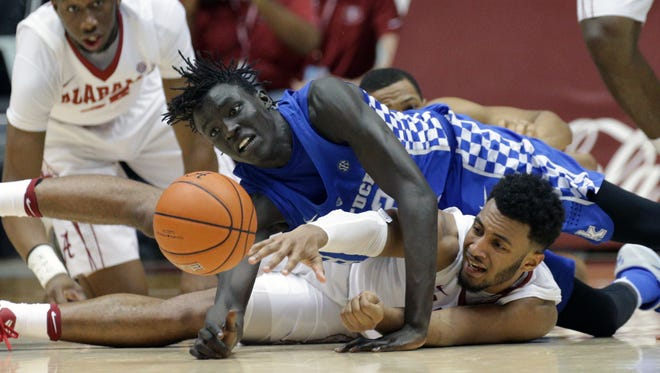 Alabama Crimson Tide forward Braxton Key (25) goes for the ball along with Kentucky Wildcats forward Wenyen Gabriel (32) during the second half at Coleman Coliseum on Feb. 11.