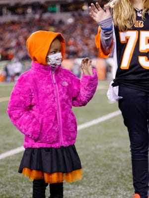 Cincinnati Bengals defensive tackle Devon Still (75) daughter Leah Still is honored on the field after the first quarter during their game against the Cleveland Browns at Paul Brown Stadium along with a donation to Cincinnati Children's Hospital Medical Center. The Enquirer/Jeff Swinger