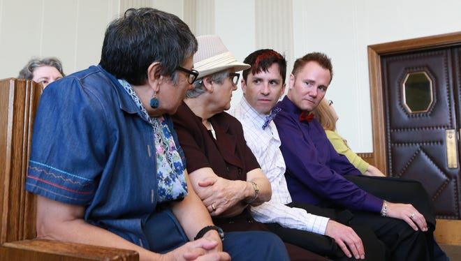 Same sex couples, from left, Zuleyma Tang-Martinez and Arlene Zarembka; and LeRoy Fitzwater and Alan Ziegler, all of St. Louis, talk in the courtroom before on Missouri's same-sex marriage ban, Thursday, Sept. 25, 2014, in Kansas City, Mo. Couples challenging Missouri's refusal to recognize same-sex marriages legally performed in other states say there is no public interest in denying them the same rights as married heterosexuals. (AP Photo/St. Louis Post-Dispatch, Christian Gooden, Pool)