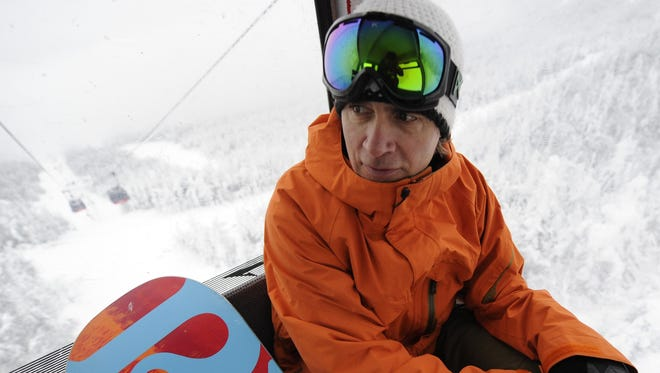 Jake Burton, founder of Burton Snowboards, rides the gondola at Stowe Mountain Resort in 2010.