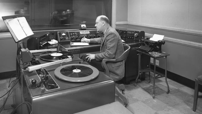 An announcer takes the mic at Radio City, the studio for WTMJ-AM, in this undated photo. WTMJ, which began broadcasting on AM in 1927,  has begun airing on FM at 103.3.