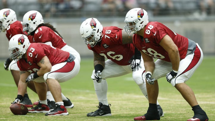 TOP: The Cardinals offensive line, including center