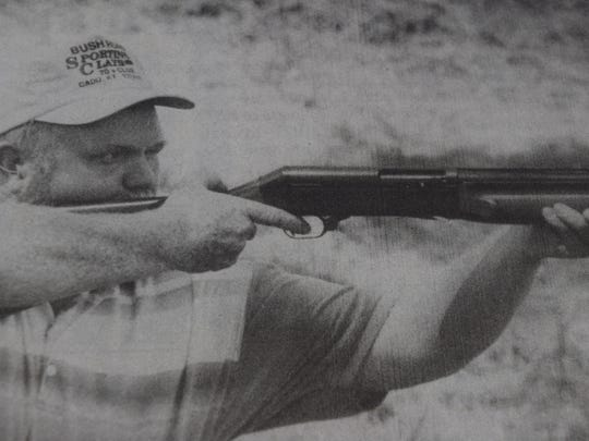 Wendell French of Morganfield prepared to shoot a clay target as he shot with his son, Steven in August of 1995.
