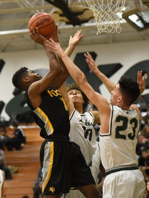 North Farmington guard Kendall Hayes (11) puts up a