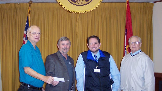 The Mountain Home Elks Lodge recently donated $250 to Hospice of North Arkansas Promise Foundation, which provides services beyond normal hospice services for local hospice patients. Shown are (from left) Don Swanson, Elks president; Ken House, Hospice of North Arkansas Owner; Chris Loftis, Hospice of North Arkansas Sr. Patient Care Representative, and Elks benevolence committee member, Butch Holligan.
