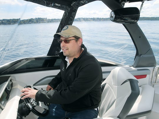 Shawn Ottenbreit, owner of Freedom Boat Club, drives one of the speedboats available at the Bremerton Marina to members of the club.