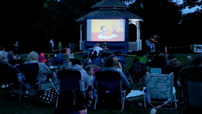 "Residents enjoy ""It's the Great Pumpkin, Charlie Brown!"" during Movie Night at Morgan's Farm in Cedar Grove. The Municipal Alliance Committee and Recreation Department sponsored the Oct. 21, 2017, event."