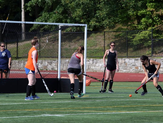Members of the White Plains field hockey team practice