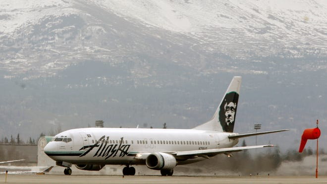 This file photo from April 22, 2009. shows an Alaska Airlines jet at the Ted Stevens International Airport in Anchorage.