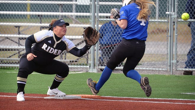 City View baserunner McKenzie Cave (4) was safe at first base as Rider's Jaida Vinson takes the throw. City View defeated Rider Friday afternoon, 5-3, in the Sunrise Optimist Softball Tournament.