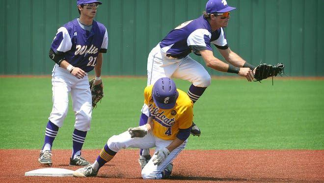 Godley Wildcats baserunner Bobby Goodloe collides with Abilene Wylie's shortstop Zach Smith as second baseman Gatlin Martin looks on. Goodloe was out on the play during the first game of a double header Wednesday at Hoskins Field.