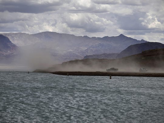Wind kicks up dust on an area that was once underwater at the Boulder Harbor boat ramp in the Lake Mead National Recreation Area, near Boulder City, Nevada. Federal water managers are projecting Lake Mead will drop to levels in January 2017 that could force supply cuts to Arizona and Nevada.