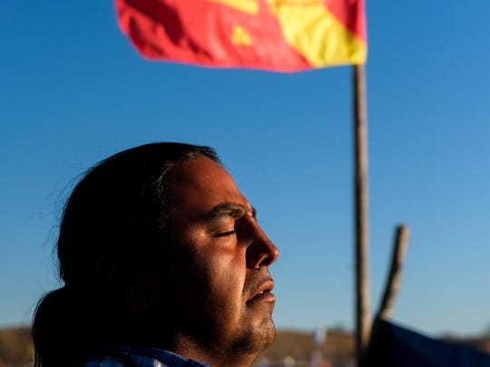 Alphonse LeRoy of the Yankton Sioux Nation and a seventh generation pipe carrier poses for a portrait outside of one of Yankton's campsites at Oceti Sakowin near Cannon Ball, N.D. on Saturday, Nov. 12, 2016. LeRoy has been hit with rubber bullets on three different occasions, a bean bag once and has been pepper sprayed several times while performing prayers and songs on the frontline at demonstrations.