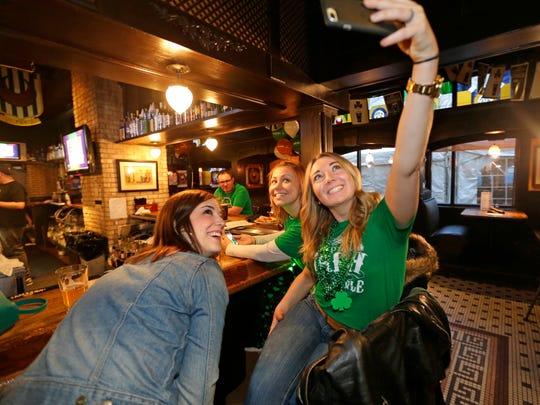 Sam Winner (far right) and friends Kathy Keelan (center) and Jessica Hurlebaus grab a group selfie at Trinity Three Irish Pubs on St. Patrick's Day in 2017. Trinity Three is just one of several Milwaukee establishments celebrating St. Patrick's Day this Sunday.