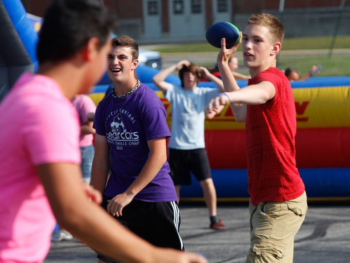 "Jacob Prybylla throws a foam football with friends at Muncie Central's ""Party in the Parking Lot"" on Friday in the parking lot of Muncie Central. The event was meant to be a meet and greet for central students with the influx of new faces from Muncie's former Southside HIgh School."