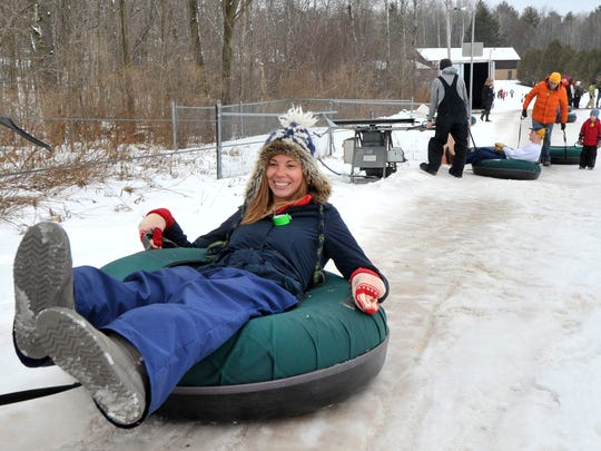 Lauren Feemster, of Wausau, gets pull on her snow tube Friday, Dec. 26, 2014, at Sylvan Tubing Hill in Wausau.
