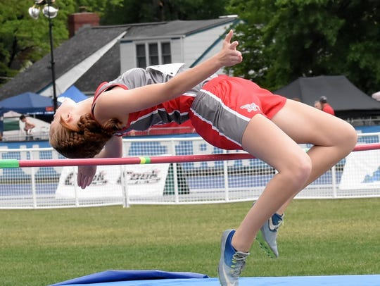 Dixie Heights' Allison Arnett arches over the bar in