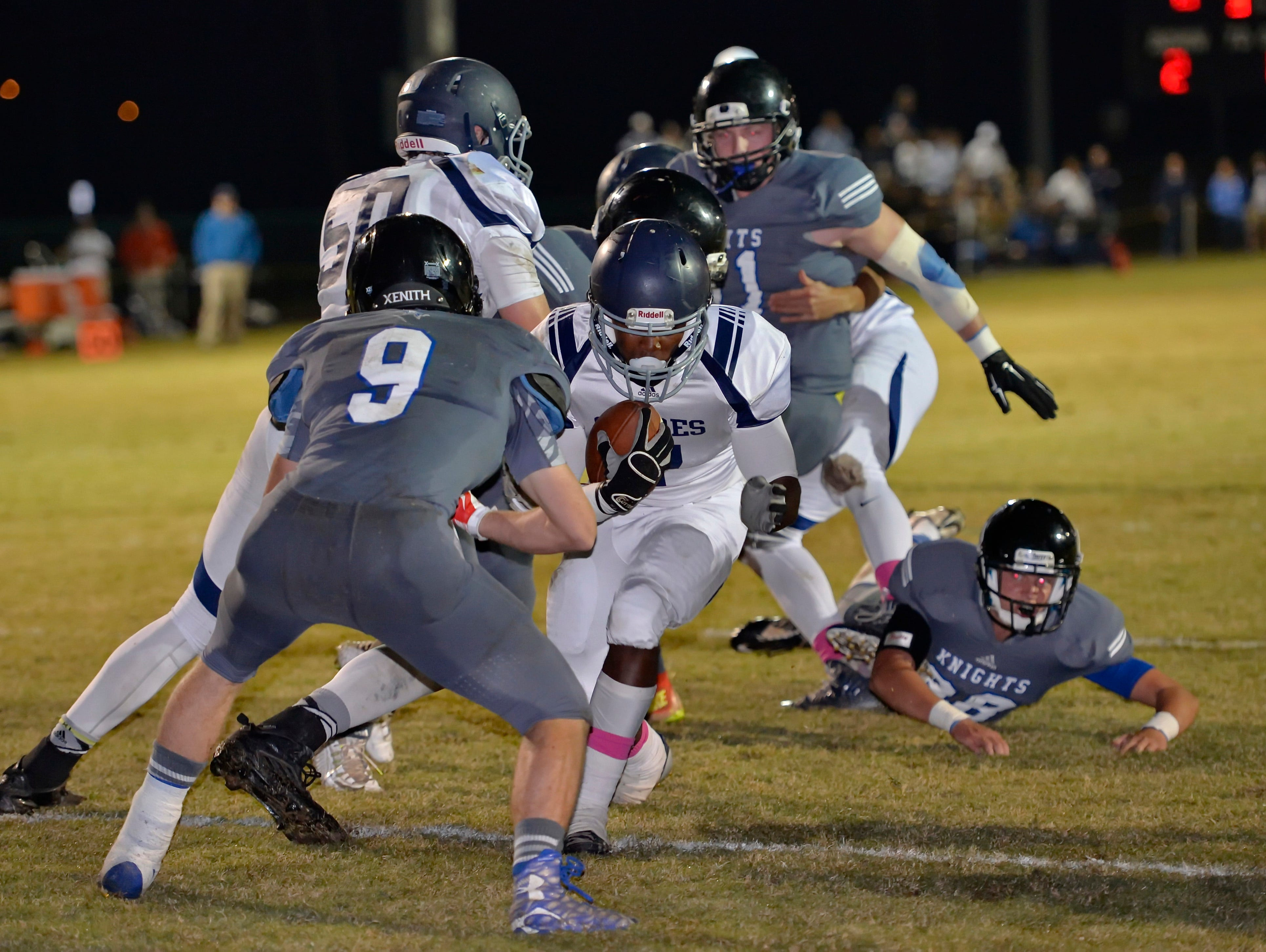 Southside Christian's Quintyn Reeder scores a first half touchdown against St. Joseph's Friday night.
