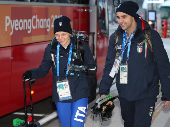 Arriving at the Olympic stadium together, husband and
